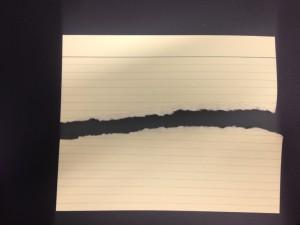 Paper torn across horizontal plane