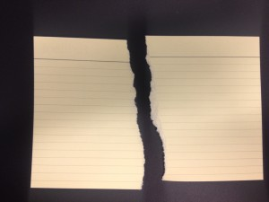 Paper torn on vertical plane